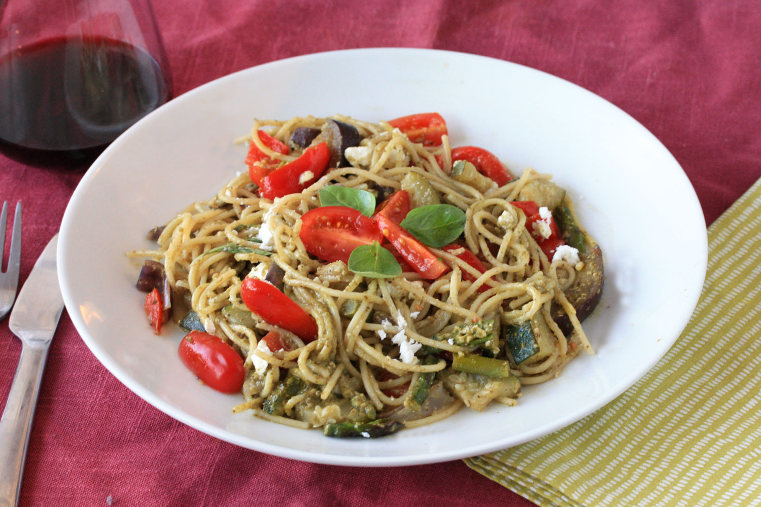 Roast vegetable spaghetti with basil pesto and cherry tomatoes