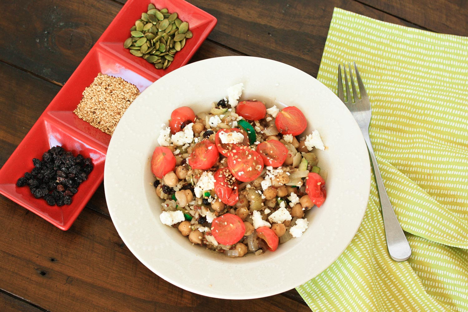 Super-filling seeds and grains salad with roasted cherry tomatoes