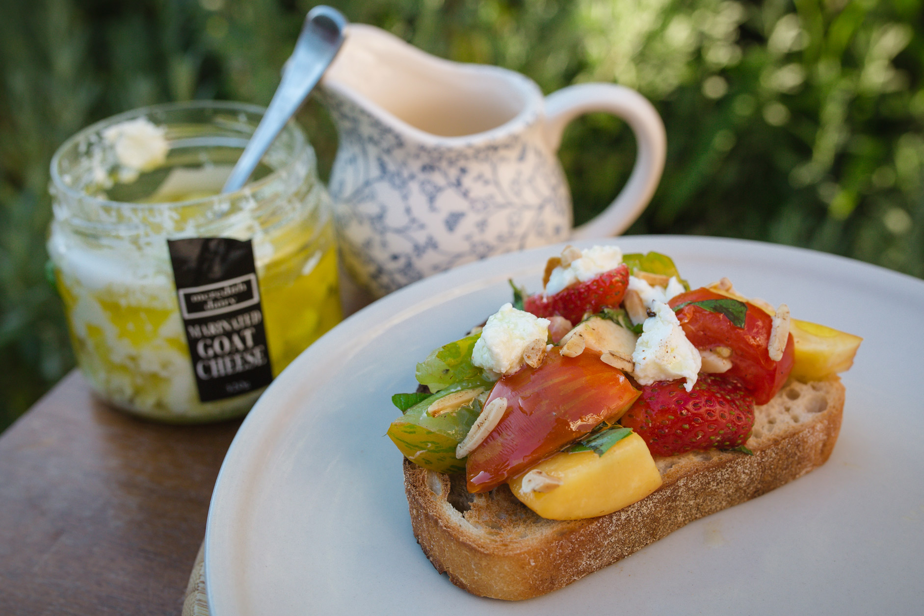 Heirloom tomato, nectarine and strawberry bruschetta with basil and feta