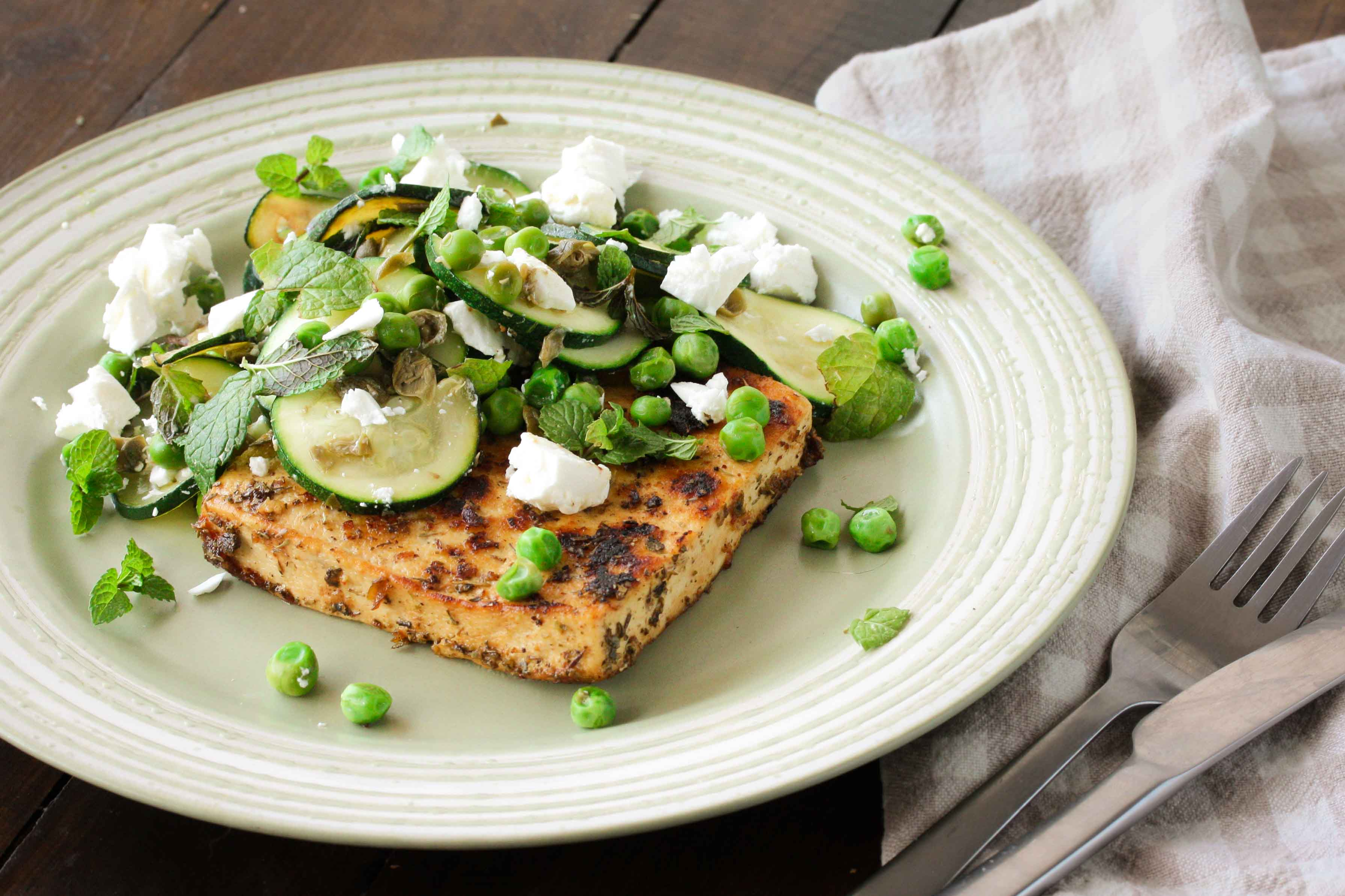 Lemon and herb tofu steak with warm zucchini, pea and mint salad