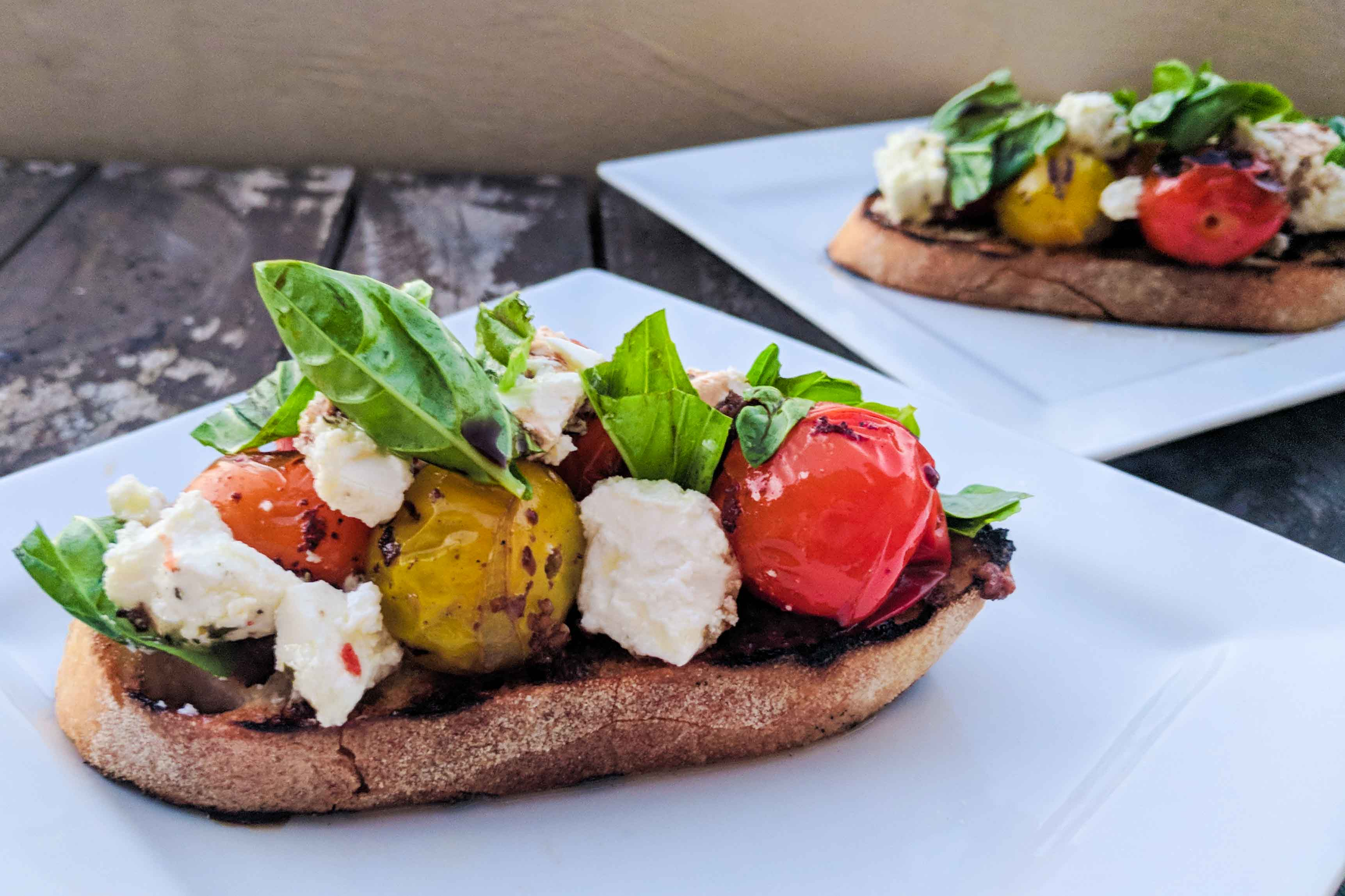 Barbecued heirloom tomato bruschetta with feta and basil