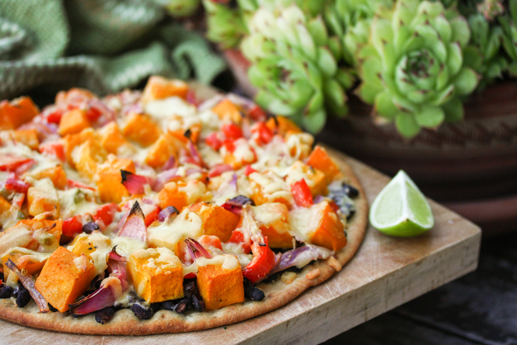 Mexican black bean and pumpkin pizza with lime, coriander and yoghurt